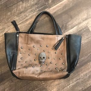 Leather tote gun metal stud and scull detail